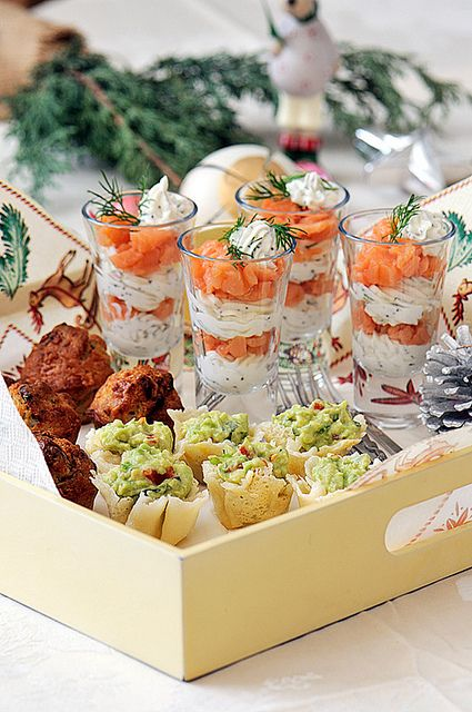 Salmon and cream cheese in glasses with other appetizers