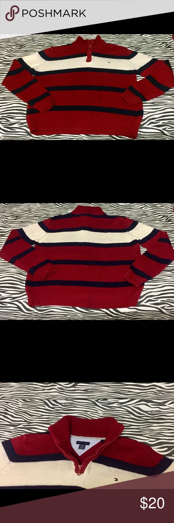 Boys Tommy Hilfiger 3/4 Zipper Sweater. 100% Cotton Red/Navy Blue/ White with a 3/4 zipper. Size S/P (8-10). Small spot on front. 20in Long, 18in Chest and 20in Sleeves from wrist to Shoulder. Tommy Hilfiger Sweaters
