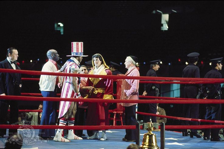 Still of Sylvester Stallone, Carl Weathers, Tony Burton and Burgess Meredith in Rocky (1976) http://www.movpins.com/dHQwMDc1MTQ4/rocky-(1976)/still-943752192