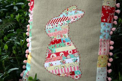quilting and applique - this pillow is absolutely adorable...bunny pillow with pompoms...pompom trims are a weakness :)