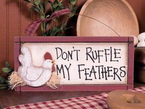 """Don't Ruffle My Feathers"" novelty sign. Made of painted wood and wire with cloth accent bow and 3D cutouts. Dimensions: 5.5"" H X 12"" W X 1.125"" D Shipping weight: 2 lbs. CLEARANCE!"