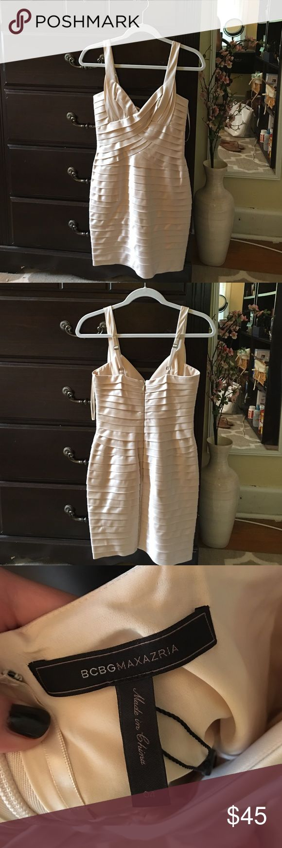 BCBG cream cocktail dress, never worn Cream cocktail dress. Hugs your curves and shows off your body in the most magically flattering way! BCBG Dresses Mini