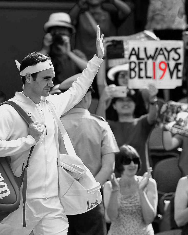 """""""""""Roger Federer moves on to Round Two after his opponent Alexandr Dolgopolov retires with an injury during Round One of Wimbledon in London, England on July 4, 2017 """" """""""