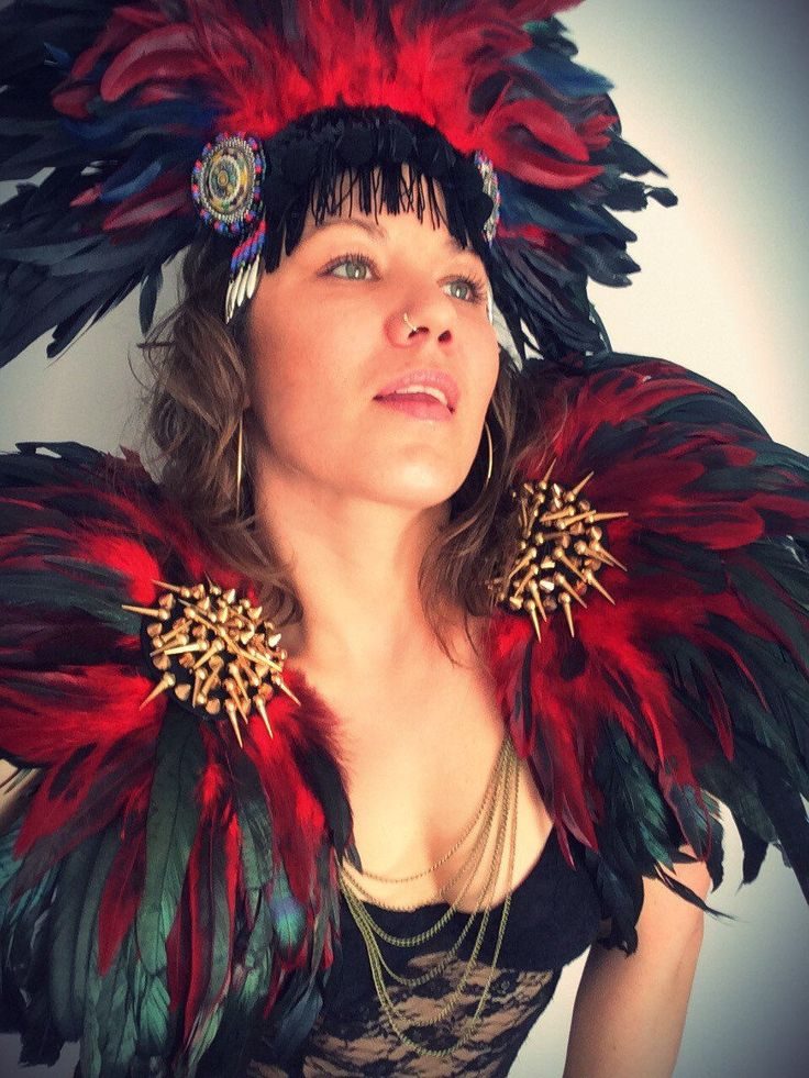 Black and red feather studded wings. Burning man, burner babes! Shop the look at feathersandthreaduk on Etsy or www.wildthing.com