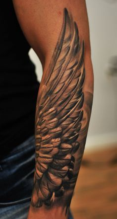 Winged forearm tattoo