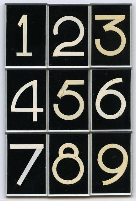 "Pootjes numerals black. Glass lettering by Pootjesglas, Hilversum, circa 1960. Font name ""DIK CIJFER"", Size #3, white on black. (Collection Piet Schreuders, Amsterdam)"