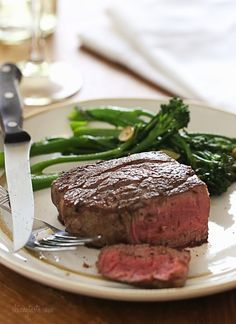 As a steak lover, I can't think of a better meal to enjoy for Valentine's Day. Since it can be pricey, I only make it on special ocassions – and Valentine's Day is the perfect occasion! Get sizzling in the kitchen for an easy, Romantic dinner for two.     Filet mignon is the most tender cut of steak you can buy, and doesn't require fancy seasonings – coarse salt and fresh cracked pepper is all you need for a delicious steak that's pan seared then finished in the oven and cooked to…