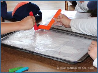 Mini Ice Hockey rink from a cookie sheet. Tiger Cubs