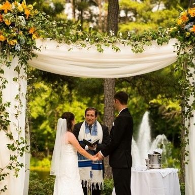 What a gorgeous look! Love the #chuppah #canopy that brings this lovely couple together. Photo via #SouthernBrideAndGroom
