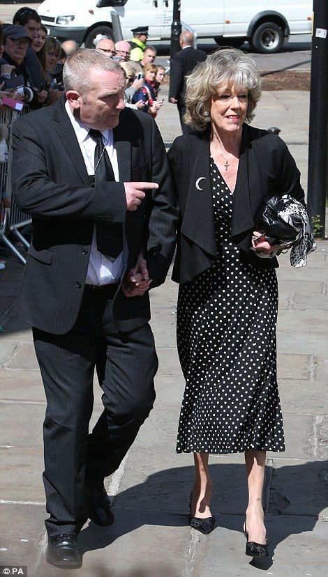 Sue Nicholls and her partner arrive for the memorial service