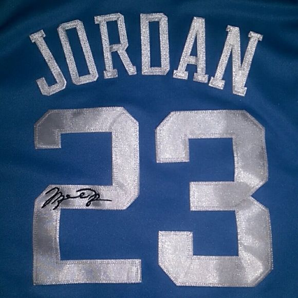 1981-1984 Hardwood Legends North Carolina Michael Jordan Jersey. All numbers and lettering are sewn/stitched on. On back side on number 2 Michael Jordan's Autograph sewn on. No stains or marks. PRICE IS FIRM Hardwood Legends Tops