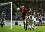 Stoyan Kolev of Lokomotiv Plovdiv saves from El Hadji Diouf of Bolton Wanderers