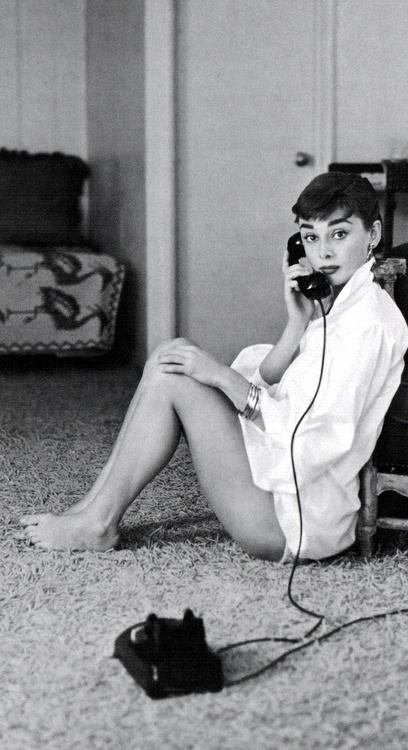 Audrey Hepburn taking a call.