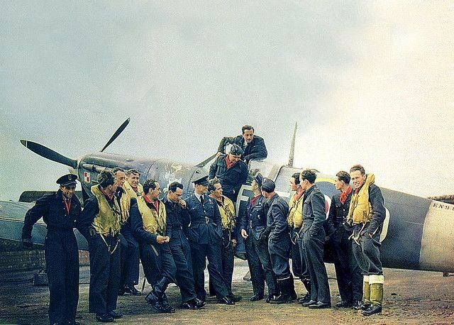 No. 303 Polish Squadron. Pilots of this famous squadron pose with their Sqn.Ldr. Jan Zumbach in front of his Spitfire V at Kirton-in- Lindsey in Oct. 1942.