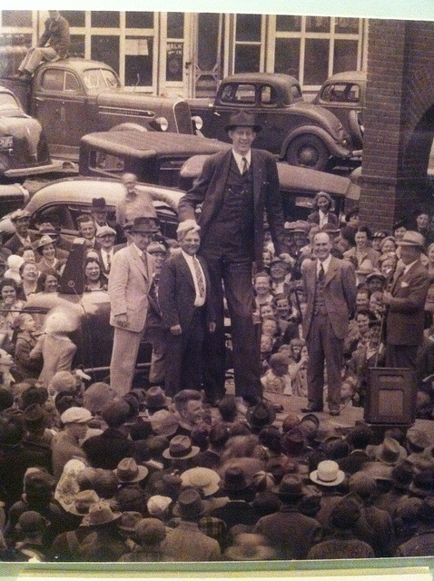The world's tallest man, Robert Wadlow, standing in a crowd. He's probably close to the height at his death, 8'11''.
