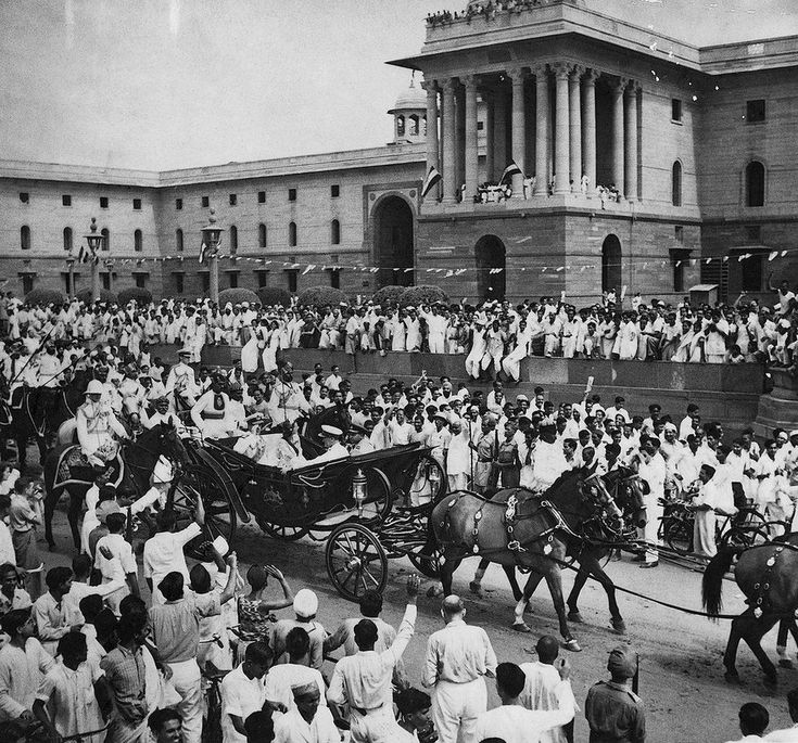 Lord Mountbatten in a ceremonial buggy ride in Delhi on 15 August 1947 amid crowds