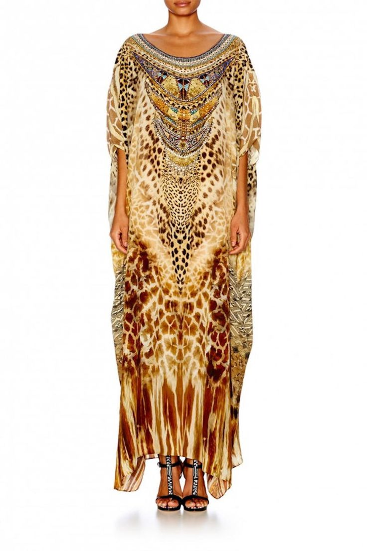 Offering a rich, lavish and exotic display of African tribes and animals, our pure silk Round Neck Kaftan feels magnificent to the touch. In a relaxed fit, the fluid silk crepe fabrication and hand embellished crystals make this number a bohemian wardrobe treasure. - Long round neck kaftan - Mid-length draped sleeves - Neckline and crystals at front - Exclusive CAMILLA print - Versatile piece with over 10 ways to style Fabrication: Silk Crepe Embellishment: Crystals Size Range: O/S…