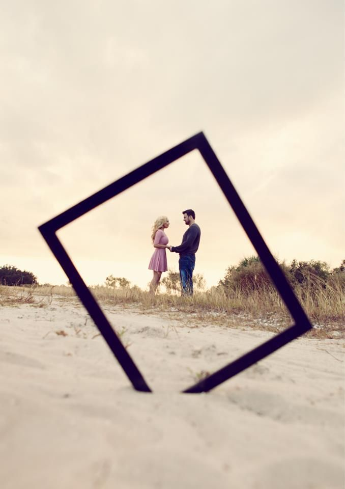 save the date / engagement picture ideas. LOVE the frame, LOVE the sand, LOVE that it's at an angle :) Find more Engagement Session Ideas at Wediquette & Parties- Your Source for Information & Inspiration to Make Your Big Day...Yours! Thanks Monir Rouhani (the lovely bride) and Kevin Michael (the talented photographer) for sharing!