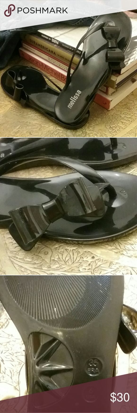 Original Melissa black jelly sandals w bow sz 6 Original Melissa black jelly sandals with a bow on the sides size 6, made in Brazil. Only worn a few times, they are in excellent condition, easy to clean! Melissa Shoes Sandals