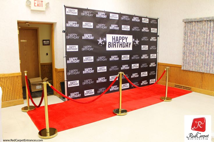 Hollywood red carpet birthday themed event. VIP red carpet backdrop with plush authentic CelebRed™ event carpet. Brass stanchions, velvet red velour ropes. Happy Birthday!