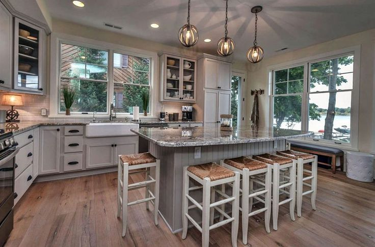 Cottage kitchen with island, wood flooring, and farmhouse sink  VintageStyleLiving.com