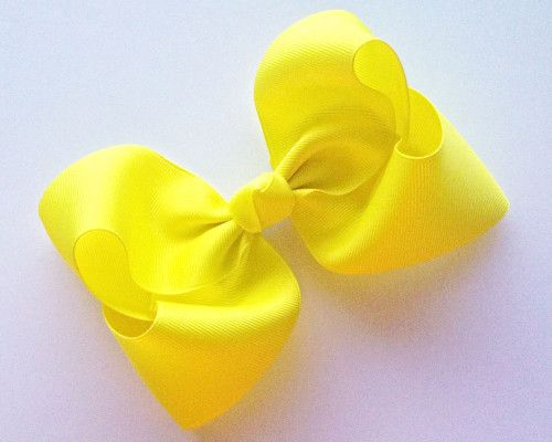 Big girl boutique bow tutorial!  We love big hair-bows and this one comes together quickly! Join Brittany on the blog for complete instructions on how to make this classic bow...