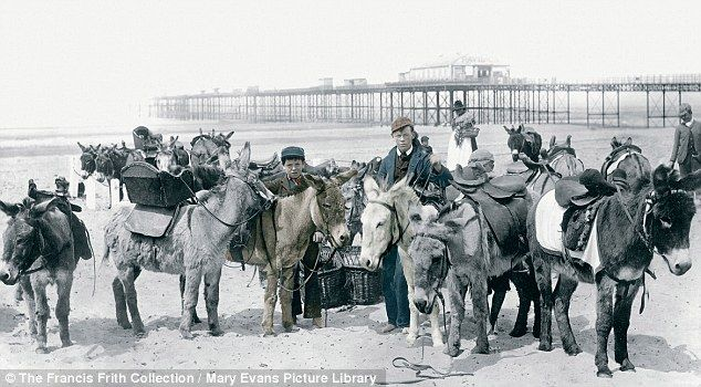 Donkeys, as ever, look gloomily resigned to a long day on Rhyl Sands in 1891. Behind stands the grand Victorian Pier, built in 1867 for £23,000