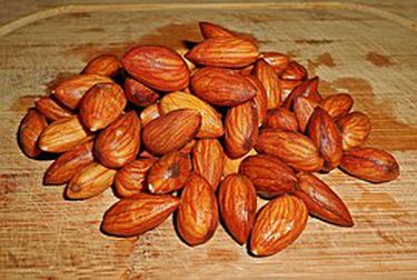 Spiced Almonds  Almonds are a nutritional powerhouse. They are rich in vitamin E, calcium, magnesium and potassium. Additionally, almonds are a significant source of protein and fiber, while being naturally low in sugar. Many of the nutrients in almonds help contribute to increased heart health. The magnesium is critical in preventing heart attacks and hypertension. Vitamin E may help stop the development of plaque in your arteries.