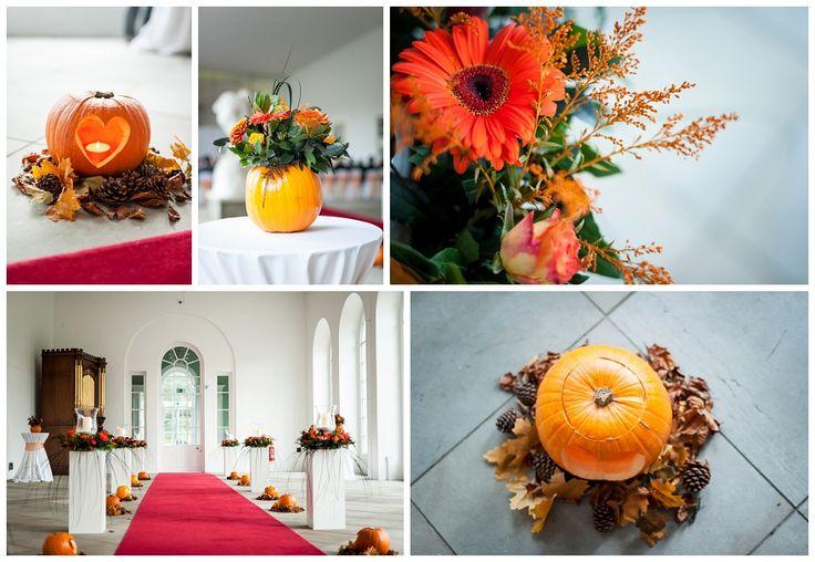 flower filled pumpkins for a halloween wedding