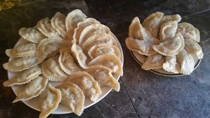 Polish pierogi with chicken and mushrooms Cooked chicken grind, add fried onions and mushrooms.  Spice up with salt, black pepper, and nutmeg.  Make a dough - flour, 1 egg, and warm water.  Flat the dough, cut circles,  and fill them with the chicken mix. Ready pierogi cook in the salted water.