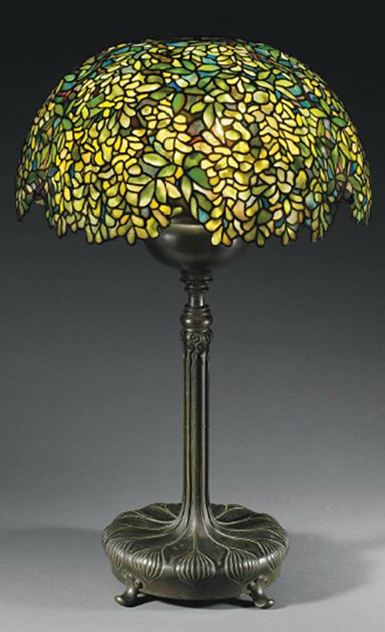 Tiffany Studios 'Laburnum' Leaded Glass Shade with an assembled bronze adjustable base, 34¼ in. (87 cm.) high, 21¼ in. (54 cm.) diameter of shade, ca. 1910