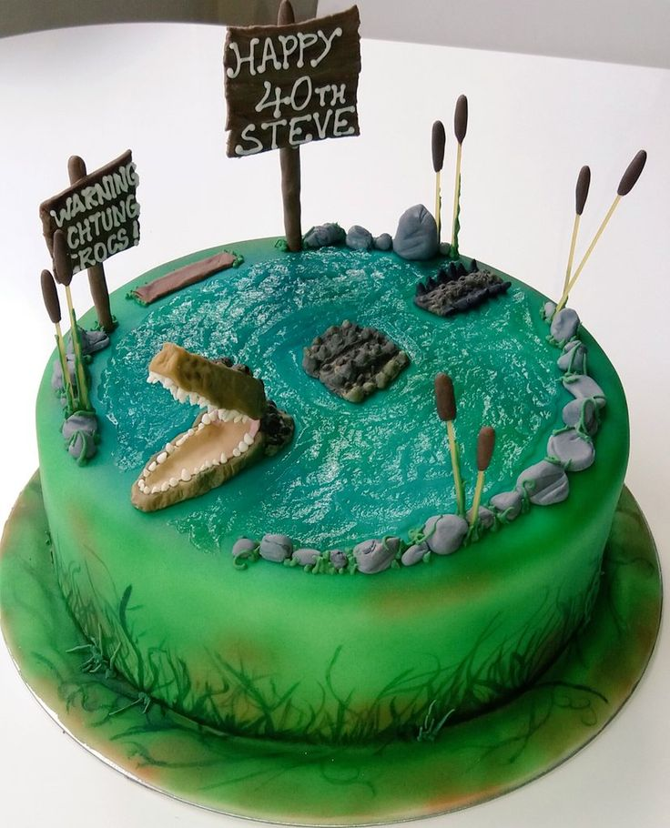 Crocodile cake handpainted watery scene. Sugarpaste decorations all made by www.eveycakes.co.uk