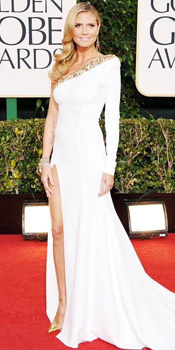 Heidi Klum in an asymmetrical Alexandre Vauthier gown with one sleeve and high slit at Golden Globes 2013