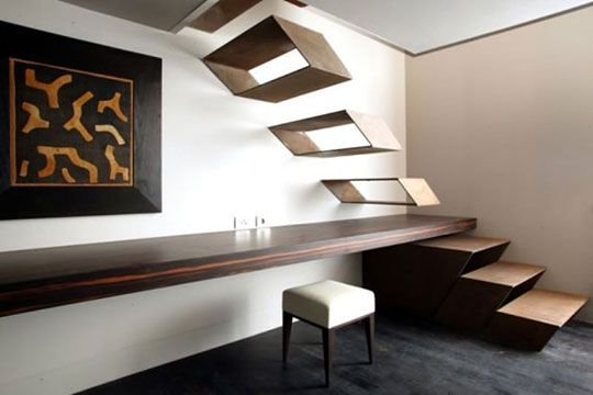 Unique staircase design. I would NEVER be able to work up the courage to walk up, or worse - DOWN - these stairs.
