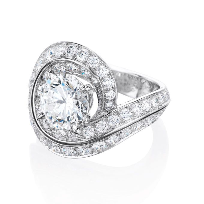 """Brides.com: Unique Engagement Ring Settings. Style 10048, """"The Crest Ring"""" four prong-set round brilliant-cut diamond with pavé diamonds set in white gold, price upon request (center stone not included), De Beers  See more De Beers engagement rings."""