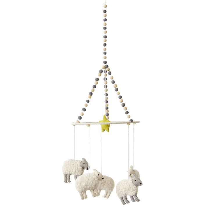 Mobile | Counting Sheep | Nursery | Kid's Rooms | Petit Pehr | Crafted by skilled artisans out of felted wool, the counting sheep mobile features five sheep and a hanging star. The perfect touch to hang over a rocking chair, crib, or changing table.