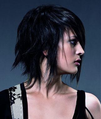A Medium Black Straight Wavy Choppy Messy Hairstyle By
