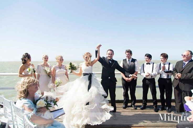 I now pronounce you MR & MRS! I loved my jetty wedding! Even though it was so windy! I loved how the Vera wang Eliza wedding gown flowed in the wind! And I loved my white Tiffany chairs! And I loved my mismatched bridesmaids  and groomsmen! I just loved it all!