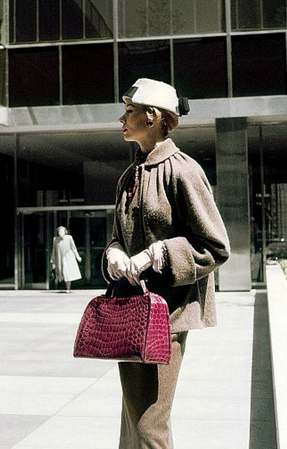 1952 Model in brown full jacket carrying a crocodile handbag by unidentified designers