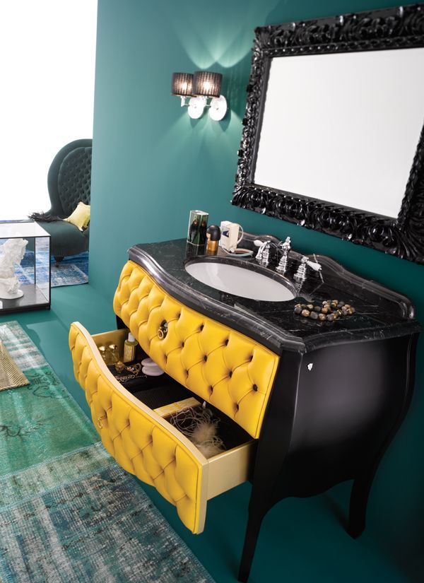 Cameo Black lacquered with ocra leather upholestered drawers.