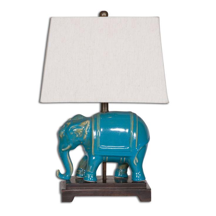 Прекрасная керамическая лампа в виде слона от производителя Uttermost. Рассчитана на 100W.             Материал: Металл, Ткань, Керамика.              Бренд: Uttermost.              Стили: Классика и неоклассика.              Цвета: Белый, Синий, Темно-коричневый.