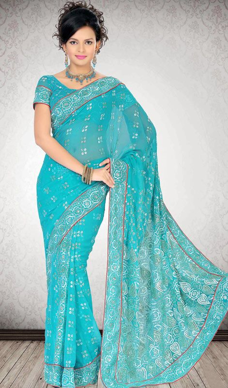Turquoise Embroidered Faux Georgette Saree Bestow a youthful look to classic style as you wear this grey and black shade net and velvet half and half saree. The gorgeous multi, patch and resham work a considerable feature of this dress. Comes with a matching stitched round neck blouse with 6 inches sleeves. #FauxGeorgetteSareePrice #ShopOnlineForIndianSarees