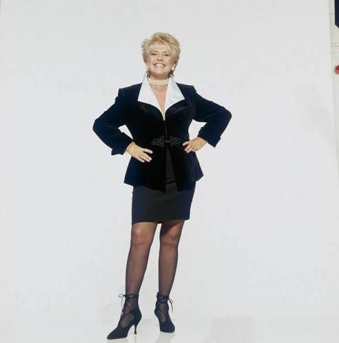 """Gloria Hunniford Black Skirt Suit by Terry O'Neill   Irish radio and television presenter Gloria Hunniford, circa 1985.  Limited Edition C-Print Signed and Numbered  16"""" x 16"""" / 20"""" x 20""""  24"""" x 24"""" / 30"""" x 30""""  40"""" x 40"""" / 48"""" x 48"""" / 60"""" x 60"""" / 72"""" x 72""""  For questions or prices please contact us at info@igifa.com     IGI FINE ART"""