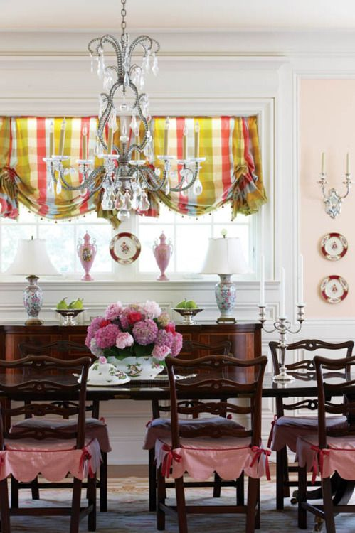 My poor hubby is surrounded by women, so I would never do a pink dining room to him, buti LOVE it!