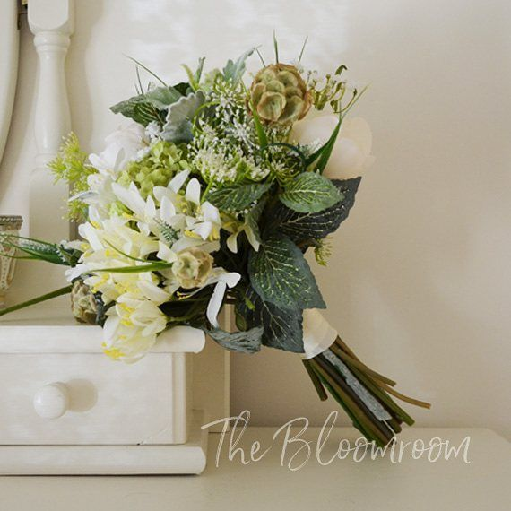Our Chloe bouquet is becoming quite popular, with it's mix of cream flowers and an abundance of greenery it's not a surprise. Perfect for a woodland wedding.  #bloomroomdesigns #silkbouquet #silkweddingflowers #bridalbouquet #bouquet #etsyweddings #etsy