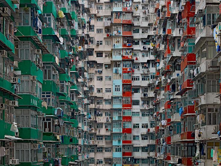 """Mind-Blowing Picture of Architectural Density in Hong Kong. With seven million people, Hong Kong is the 4th most densely populated places in the world. In his """"Architecture of Density"""" photo series, German photographer Michael Wolf explores the jaw-dropping urban landscapes of Hong Kong."""