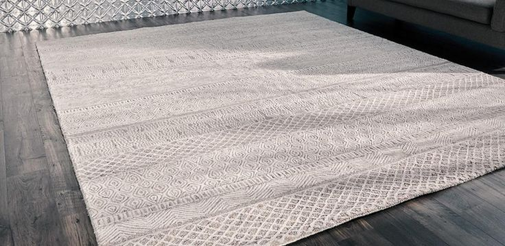 Gorgeous 100% Wool floor rug, delicately hand-tufted with intricate designs. Available in Ivory/Beige, in two sizes; 200 x 280 and 300 x 350.