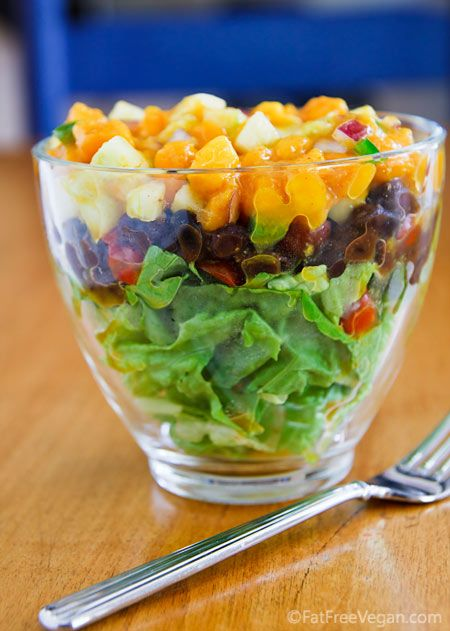 LAYERED SALAD WITH BLACK BEANS AND MANGO-CUCUMBER SALSA SALSA 2 small mangoes, diced (1 1/2 cups)  1/2 large cucumber, peeled, seeded, diced  1/4 cup diced red onion  1 jalapeño pepper, seeded and finely chopped  1 tablespoon lime juice  1/4 teaspoon red pepper  Salt to taste BEANS   1 16-ounce can black beans, drained and rinsed  1/2 cup diced fresh tomatoes (or halved grape tomatoes)  3/4 teaspoon cumin  1/2 teaspoon Ancho chile powder  1/4 teaspoon red pepper  Salt to taste