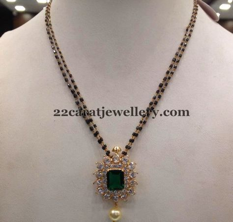 Two layers black beads short necklace with simple yet elegant look diamond locket with square shaped faceted cut emerald in the center. H...