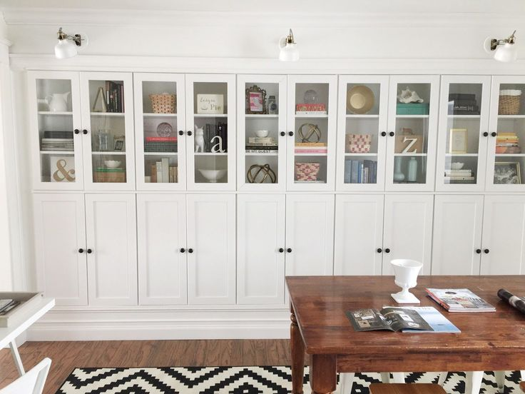 Lining a wall, a row of these cabinets seriously impresses. This blogger used glass doors on top and solid doors on the bottom, so there's space above for pretty things and plenty of hiding spots below. ( these are Borgsjo cabinets from ikea)